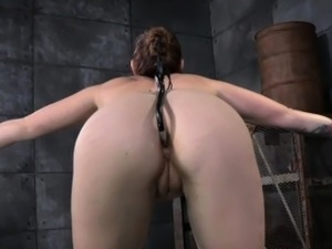 Restrained sub with anal toy spanked
