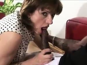 Lady Sonia sucks black cock