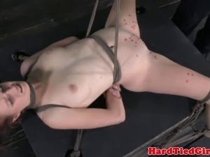 Suspended redhead sub punished with hot wax