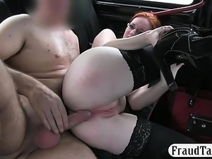 Busty red haired slut in stockings pussy fucked by driver