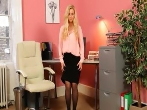 Blonde secretary in stockings posing