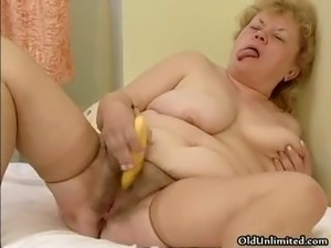 Nasty fat housewife rubs a banana on her part1