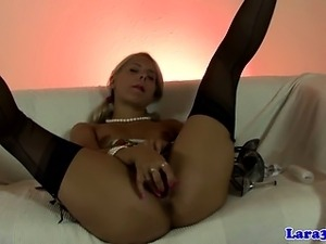 Classy stockings wearing blonde solo fun with her fingers