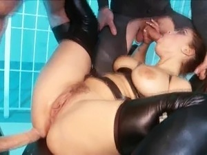 blonde in black latex stripping