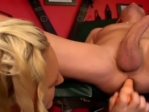 Sexy blonde dominatrix rubbing and dildoing her slaves butthole