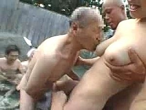 A hot busty Japanese babe gets gang banged by a bunch of old guys.