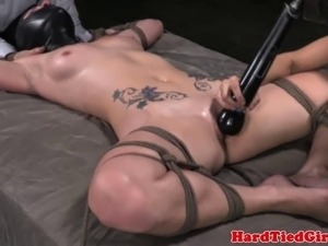Restrained and masked sub dildofucked by doms