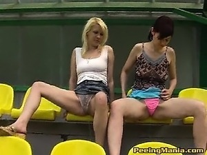 Gals peeing in the thongs at the stadium