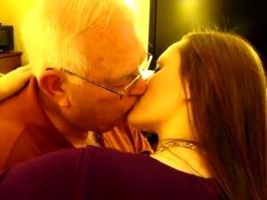 Hot Woman kissing a 82 year old man