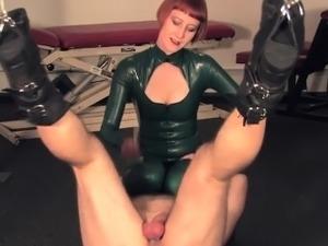 Trampling redhead dominatrix in latex