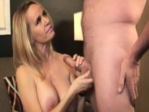 Classy cougar tugging and sucking young cock