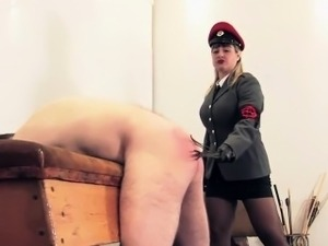 Femdom spanks subs ass with wet twigs