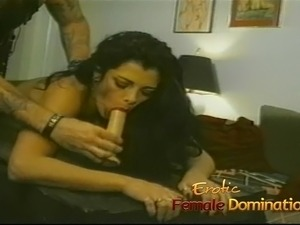 Tattooed stud dominates a beautiful girl in the bedroom