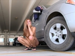 Teen in the parking lot strips and flashes her hot body