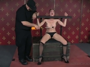 Master punishes Ashley Lane with clothed pins and black vibrator