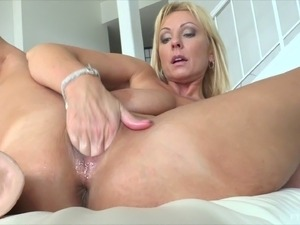Mom with gigantic dildos fucks them into her wet pussy