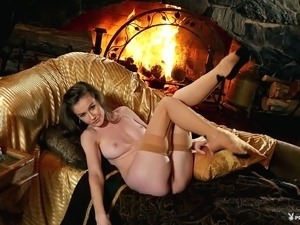 Petite beauty decides to reveal her beautiful body by the fireplace