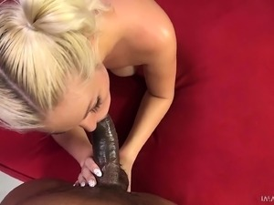 Pigtailed blonde with big boobs surrenders her pussy to a black bull