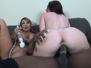Ava Devine and Jodi Taylor take turns wildly fucking a big black dick