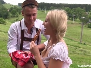 German girl in a grassy field fucking a farm guy