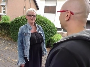 Woman with glasses seduces a bald guy who wants her warm pussy