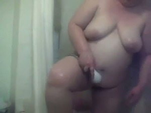 All naked and wet chubby mature housewife was flashing her big saggy tits