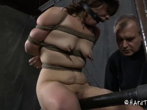 Slave undressed then having her tits pegged in BDSM