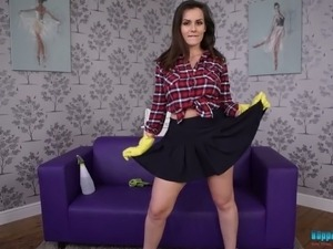 Pretty brunette Charlie Rose shows striptease on the purple couch