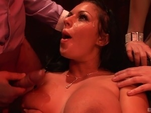 Busty brunette woman joins her friends for an awesome threesome