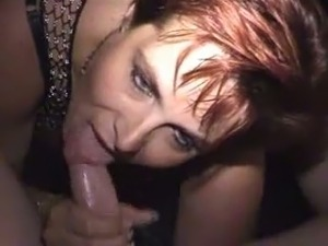 A bit chubby red haired MILF in lingerie is busy with sucking stiff cock