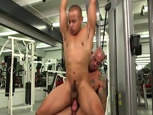 Muscly jock gets asshole filled with cock in gym