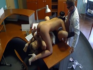 Uniformed nurse fucks in doctors threesome