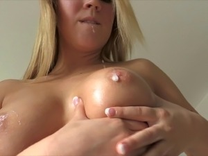 Solo model Zoey oils up her amazing, perky tits and plays