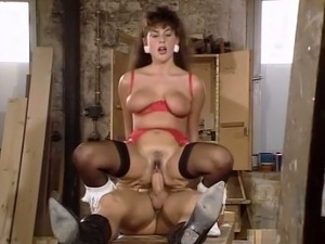 Wild and restless brunette babe riding fat cock in the workshop