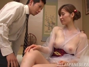 Masseuse in a sheer kimono blows and bangs her client