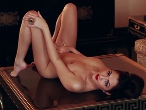 Beautiful brunette Cassie Laine poses nude at a Playboy photo shoot