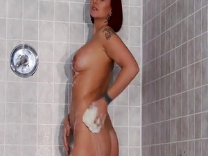 Redhead cougar finds a big cock in the locker room