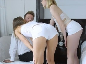 Lean young lascivious girls in the bedroom start up threesome with one man