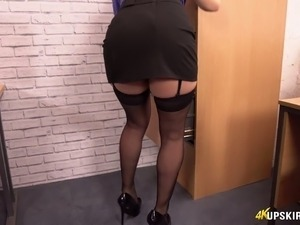 Fantastic and skanky brunette office girl flashes her booty without panties