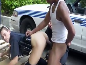 Hot police officers use black dude for sex in public