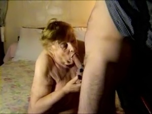 Old and fat ugly blonde woman on the bed giving head