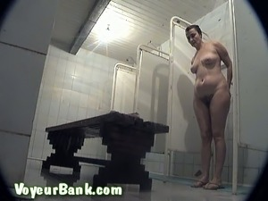 Busty and curvy amateur mature lady in the shower room on voyeur video