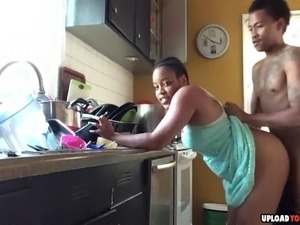 Horny black couple having a great doggystyle fuck in the kitchen