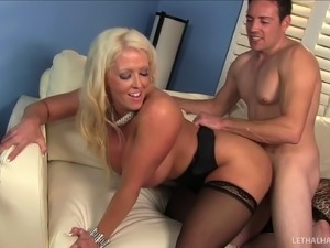 Kinky MILF with juicy tits is busy being fucked hardcore on the couch