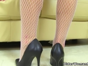 English milf Caz wears white fishnet tights and no knickers