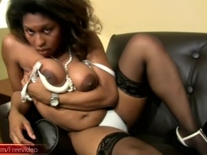 Ebony shemale gets frisky with her hot body and her big dick