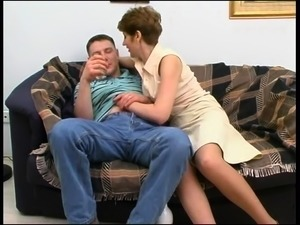 Lustful old lady in stockings gets fucked by a young guy