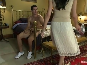 Busty dark haired ladyboy Mia Isabella makes dude groan during doggy anal