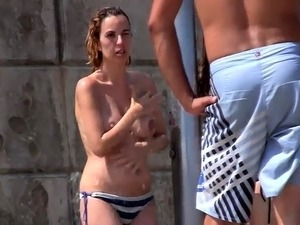 Beach voyeur shoots a sexy amateur babe with lovely big tits