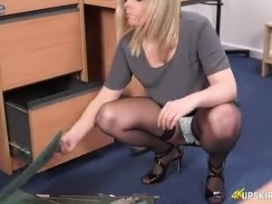 Lewd office clerk Anna Belle is ready to pet her own pussy at work